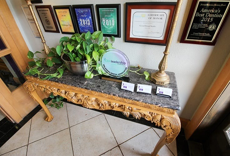 Table and wall with awards and plaques