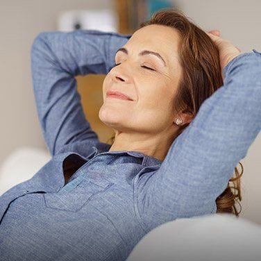 Relaxing woman with hands behind head