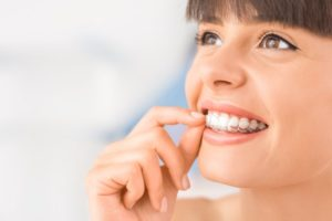 happy woman w/ Invisalign tray