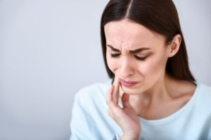 woman experiencing dental pain
